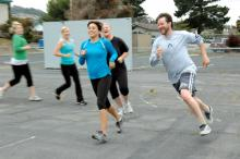 Members of Conrad's Boot Camp class grin as they work out.